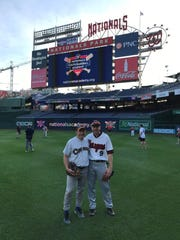 Matt Mika practices with fellow volunteer coach Brian Sutter, who is from Midland, Michigan, at Nationals Park on Thursday, June 14, 2018. Mika and Sutter previously worked together in the office of former Rep. Dave Camp, he said.