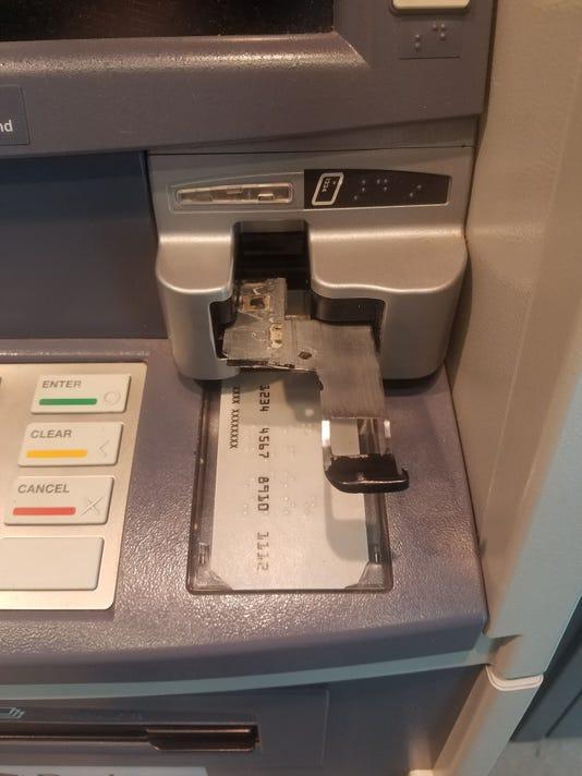 636645734690460992-credit-card-skimmer-atm.jpg