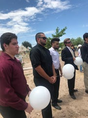 Former team mates gather in the Rio Grande Valley Wednesday to remember Jose Briones at his funeral services. He drowned at Falcon Lake on Sunday.