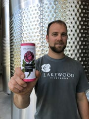 Ben Stamp, assistant winemaker for Lakewood Vineyards, holds a prototype can for the winery's Bubbly Catawba.