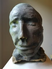 Statue head found in the Big West Creek during the solar eclipse has been identified by a family who lost him.
