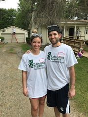 Plymouth's Lauren and Andrew Bishop were part of a group of about 35 volunteers helping paint and repair Carol Robinson's house.