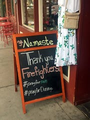 A business owner's sign on Main Avenue in downtown Durango, Colorado,  in June thanked firefighters who were battling the 416 and Burro fires.
