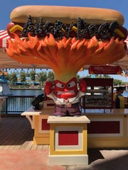 "Disneyland Resort unveiled its new land: Pixar Pier at California Adventure. The pier offers new food options, like the Angry Dogs stand, based on the Pixar film ""Inside Out."""