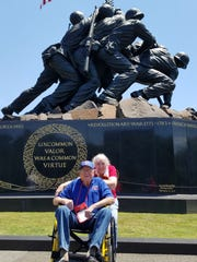 Lee Trumbo, with daughter Bobbie Byrd, pose in front of the Marine Corps monument in Washington, D.C. Trumbo and 47 others on an Honor Flight visited a number of monuments and enjoyed a concert featuring a performance by the Air Force Band.