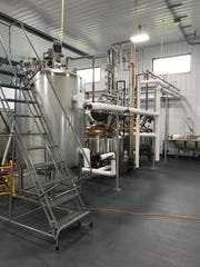 The first step in the distilling process is mashing. The product is then transferred to be fermented and distilled, which takes place in the copper-topped machines.