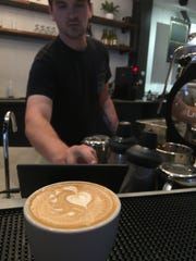 Prevail Union founder Wade Preston serves an espresso Tuesday in Montgomery.
