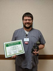 Aurora Medical Center in Manitowoc County recently presented a DAISY Award to Registered Nurse JJ Troyer for outstanding patient care.