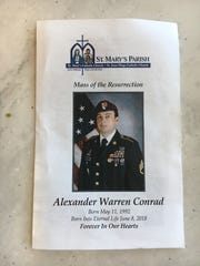 A view of the funeral program for fallen Chandler solider
