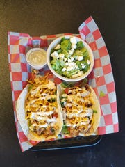 Grilled chicken tacos at Kevin's Backstage Bar and
