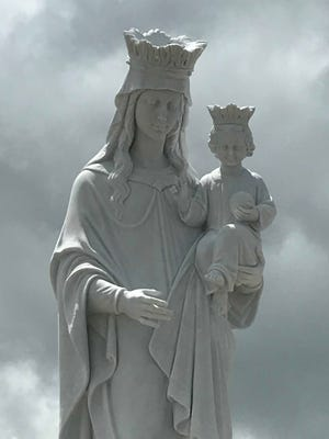 A marble statue of the Virgin Mary is the focal point of the Regina Caeli Shrine. The new shrine at St. John the Baptist Catholic Church is a place of reflection for weary souls.