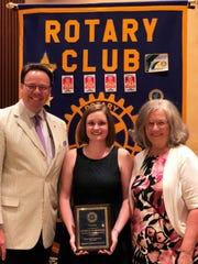 Rotary Club president Ed Anderson, ELL teacher Lindsay
