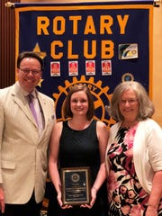 Rotary Club president Ed Anderson, ELL teacher Lindsay Marshall and Fountain City Elementary School principal Ina Langston at the Rotary Club of Knoxville's Outstanding Teacher of the Year honors in June.
