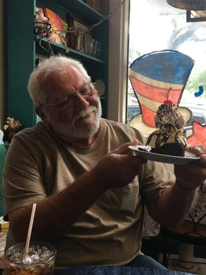 Daily World photographer Freddie Herpin takes a break from behind the camera on June 29, as he enjoys a brownie with ice cream at Back in Time in Opelousas.