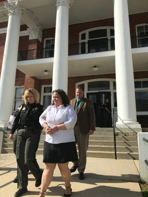 Nancy Hogan walks out of the Madison County Courthouse July 5 following her conviction on a first-degree murder charge for the July 2015 killing of Edward Praytor.