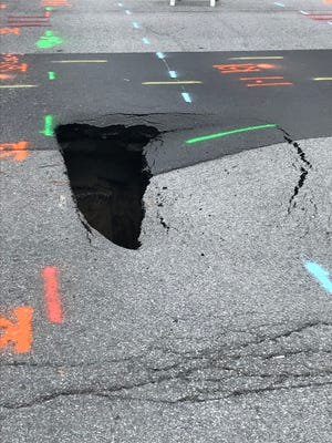 A 3-by-8-foot sinkhole opened in Downtown Indianapolis after a more than 100-year-old sewer line 15-feet underground collapsed Wednesday. Citizens Energy Group will begin repairs Friday, which likely will last through the weekend.