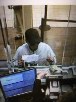 Ventura police were searching for a man suspected of robbing a Chase bank Friday.