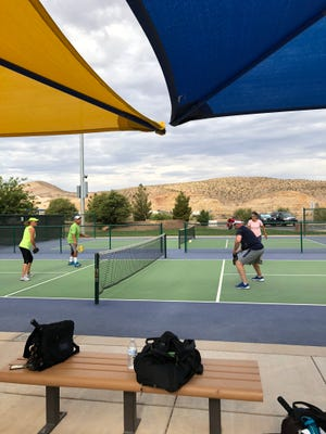 Rosemary McFadden and Troy McFadden (right side) play pickleball with friends at Little Valley Pickleball Complex in St. George on July 7, 2018.