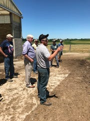 Greg Blatz shows Rep. Glenn Grothman the pasture at