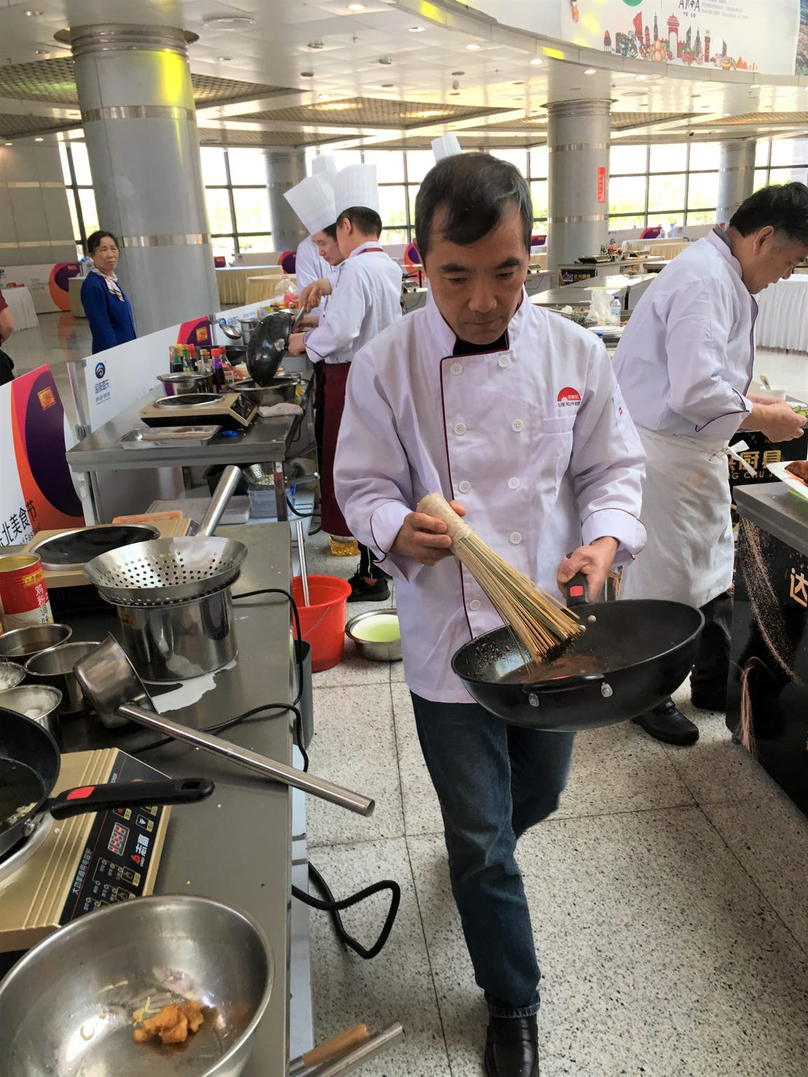 Chef Byron Huang prepares his wok for cooking at a