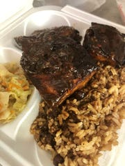 Jerk chicken with rice and peas and steamed cabbage