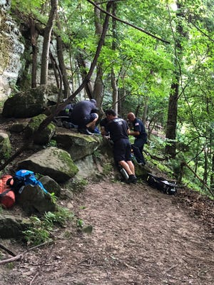 A 9-year-old boy fell about 25 feet off Mt. Pleasant could not move when rescue crews reached him