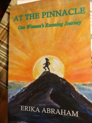 At The Pinnacle: One Woman's Running Journey, was written by local runner Erika Abraham.