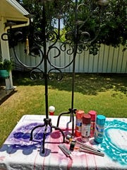 Materials needed for constructing the outdoor lighting project include: Old candle holders and solar powered landscape lights.