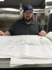 Brent Robinson of Georgia Blue restaurant group studies plans for the new Genna Benna's restaurant and GB Bakery under construction in Brandon.