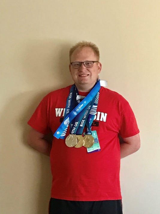 David Burkard of Manitowoc shows off his Special Olympics medals