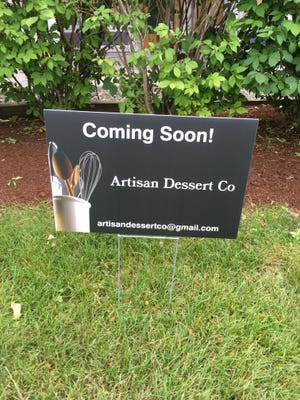 A sign for Artisan Dessert Co. is seen outside the Essex Experience shopping plaza (formerly known as the Essex Shoppes) on July 17, 2018.