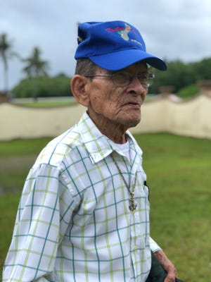 Juan Guzman, 84, originally from Sumay, reminisces about his mother buried at the Sumay Cemetery after a memorial mass held on Friday, July 20, 2018 at the cemetery.