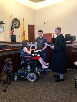 Deming social worker Kaity Ellis  was sworn-in by Judge Jarod Hofacket of the Sixth Judicial District Court of New Mexico on July 12. Holding the Bible is Kaity's cousin Jaden Ruttle.