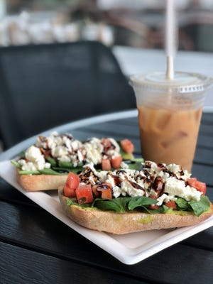Avocado toast and cold brew from MoJoe's Coffee Bar on Fort Myers Beach.