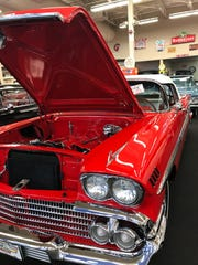 A '58 Impala stands among others from later years at Muscle Car City.