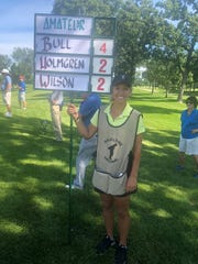 Natalie Roth, sign bearer at Hazeltine National Golf