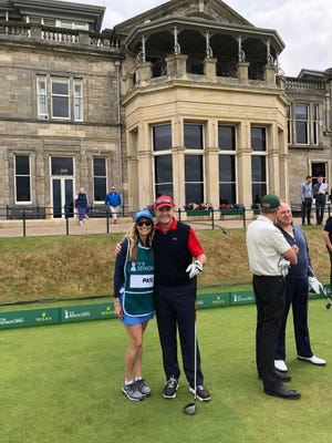 Jerry Pate and daughter Jenni on the practice green by the historic clubhouse and hotel at the Old Course at St. Andrews, Scotland where they compete Thursday in Senior British Open.