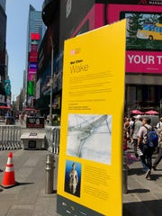 An sign in Times Square explains Mel Chin's art installation