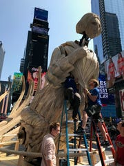 """The team of students from UNC Asheville works on constructing the Mel Chin art installation """"Wake"""" before its official opening in Times Square on July 11."""