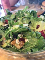 A closeup of The Fizz salad shows the fresh arugula, strawberries, dried cranberries, almonds and blue cheese.