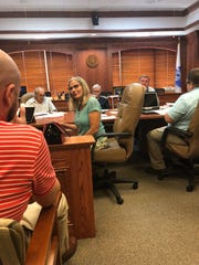 Wichita County Auditor Deb Stevens addresses a county employee about how ending a grandfathered health plan would affect her benefits as shown in this July 27, 2018, file photo.