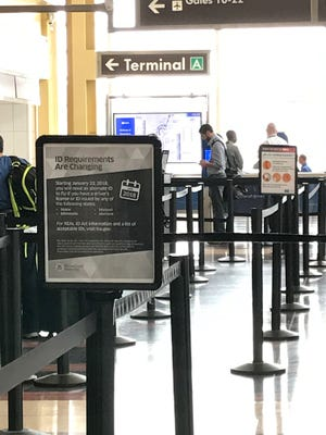 At Ronald Reagan Washington National Airport in Arlington, Va., signs alert passengers about the changes to ID requirements as TSA is set to begin enforcement of the Real ID law at security checkpoints.