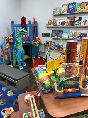 A loft in Kate's Classroom provides space for children to play.