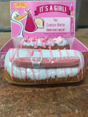 Cranky Al's in Wauwatosa sold special doughnuts to celebrate the newest member of the family on July 28 and 29. The tasty treats were vanilla long johns with pink drizzle. One sported a pink gum cigar. The other one had pink Sixlets with an edible candy baby.
