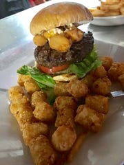 Jodi Kanzenbach pointed to specialty burgers, such as the Squeaky Curd, as being something that the pub does particularly well.