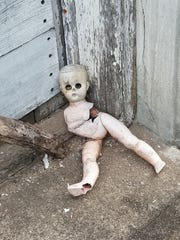 A ruined doll lies outside the former general store
