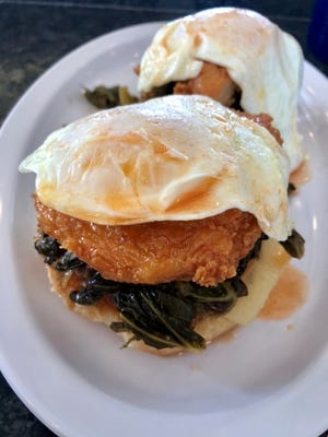 The Gateway Honey Hot Benedict from Skinny Dogz features collard greens, fried chicken drizzled in spicy honey and Gruyere on biscuits.