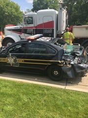 An Oakland County Sheriff's Office patrol car damaged after a crash on Woodward Avenue in Pontiac the morning of Friday, Aug. 3, 2018.