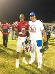 Evangel's Na'Drian Dizadare, standing with his father, Emmett, is an Oklahoma State commit.