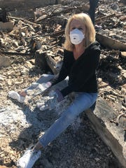 Paula Lindsay returned home to what remained of her house, and came across the ashes of her partner who had died before the fires. She rescattered his ashes.